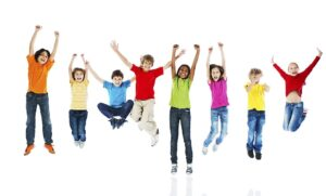 Large group of happy kids jumping with raised arms. They are isolated on white.